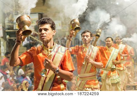 VARANASI, INDIA - May 4, 2017 : Hindu Prayers at Ganges river ghats taken on May 4, 2017 at Varanasi, India. Varanasi is one of the oldest living cities in the world & a major tourist destination