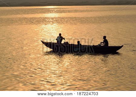 VARANASI, INDIA - May 7, 2017 : Fishermen on wooden boats at Ganges river in Varanasi India taken on May 7, 2017 at Varanasi, India. Due to Ganges river Indian civilization thrived from ancient times