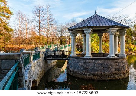 Clara Meer Gazebo and bridge over the Lake Clara Meer in the Piedmont Park in autumn day Atlanta USA