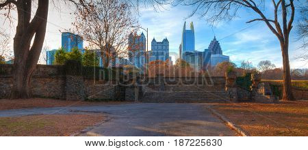 Panoramic view of stone stairs in the Piedmont Park and Midtown Atlanta behind it in autumn day USA