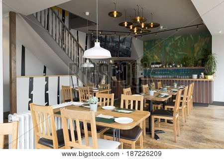 Brightly lit fully-furnished interior of a restaurant