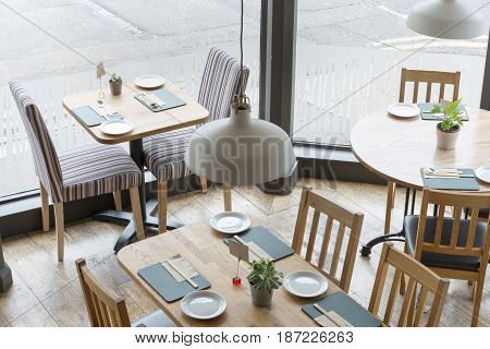 View Of Restaurant Interior With Hanging Lamp In The Middle