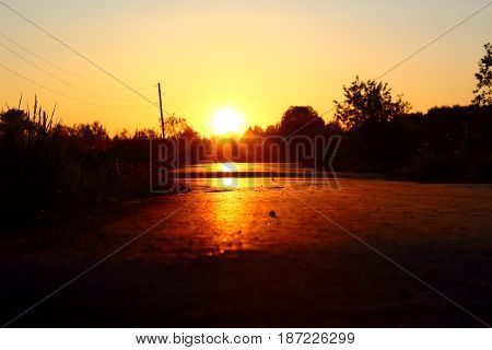 Beautiful sunrise over a paved road. Early in the morning.