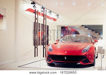 Moscow, Russia - FEB 21, 2017: Red Ferrari f12 berlinetta sports car is on display in the store.