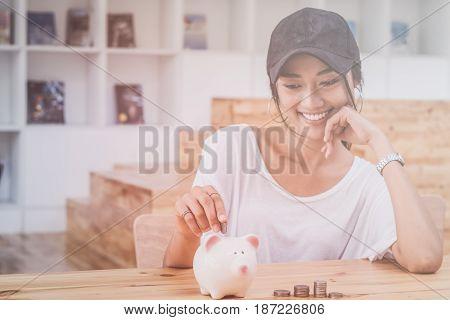 young beautiful woman saving money, selective focus, vintage