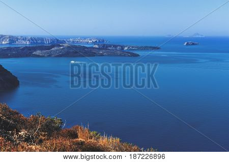 Beautiful landscape with sea view. Cruise liner at the sea near the Nea Kameni a small Greek island in the Aegean Sea near Santorini cyclades Greece