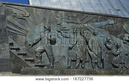 MOSCOW, APRIL 12, 2017: Metal bronse sculpture Space rocket monument on VDNKh. Symbol of Russian cosmonautics Soviet Union space conquerors space industry engineers. Gagarin, space designers engineers