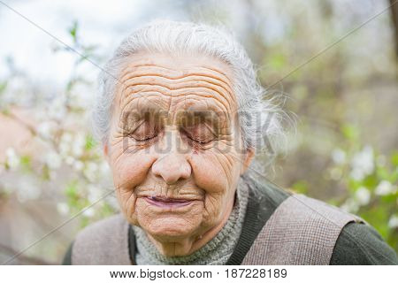 Picture of a retired elderly woman outdoor
