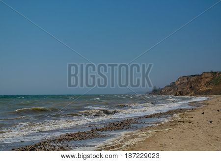 Beautiful tide on the Black Sea beach sky and sea sand and cliffs