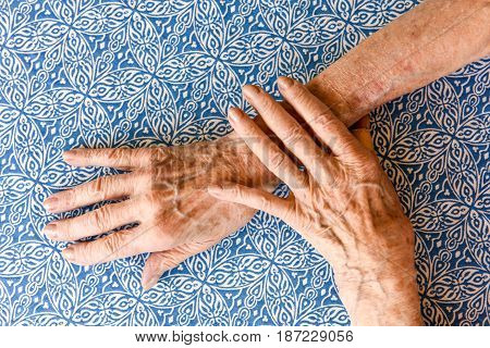Crossed Hands Of An Old Woman