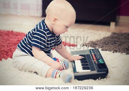 Little Baby Boy Plays On Keyboard Toy
