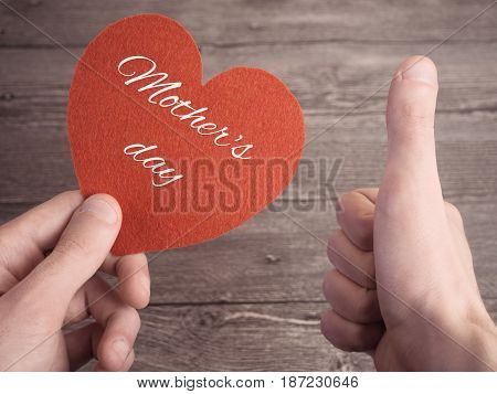 The Man's Heart In One Hand And The Second Showing Thumbs Up