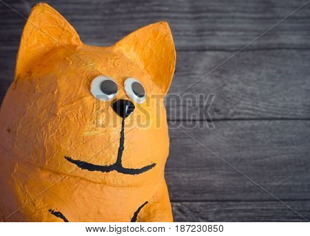 A Big Ginger Cat Toy Looking On Copy Space