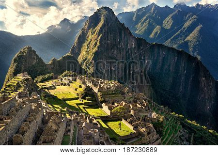MACHU PICCHU PERU - MAY 31 2015: View of the ancient Inca City of Machu Picchu. The 15-th century Inca site.'Lost city of the Incas'. Ruins of the Machu Picchu sanctuary. UNESCO World Heritage site.