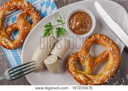 Bavarian veal sausages with pretzel. Top view