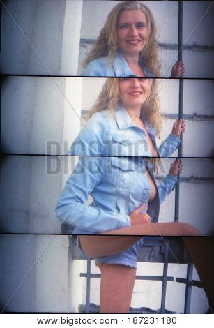 Retro photo. Sexy half-naked girl blonde in unbuttoned clothes. Attention! The picture contains the graininess of the photographic film.