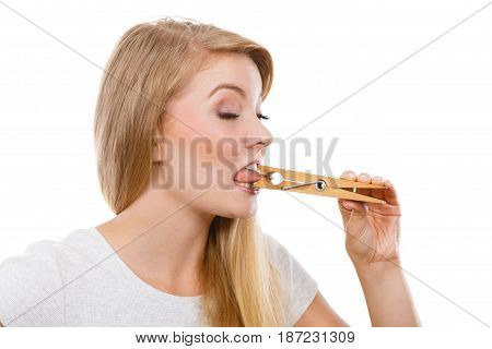 Blonde Woman Having Tongue In Clothespin