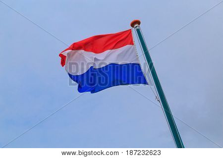 Flag of the Netherlands in the sky, selective focus.