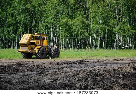 Tractor in the field with open hood.
