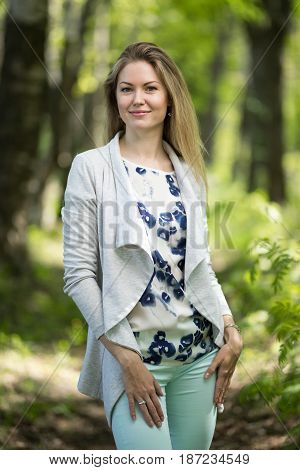 fashion girl outdoor portrait, young woman walking in summer park