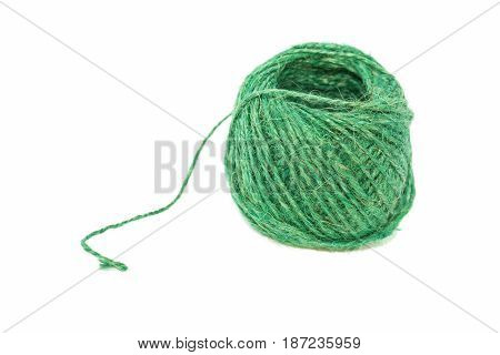 Linen thread of green color on a white background