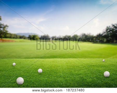 3d rendering golf balls on green grass in golf field
