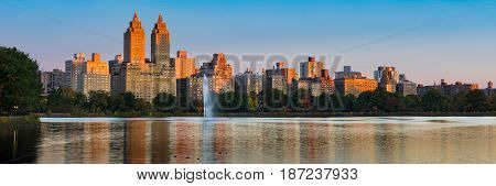 Panoramic view of Central Park West high-rise buildings and the Jacqueline Kennedy Onassis Reservoir at dawn. Upper West Side Manhattan New York City
