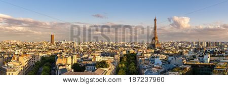 Panoramic summer view of Paris rooftops at sunset with the Eiffel Tower. 16th Arrondissement Paris France