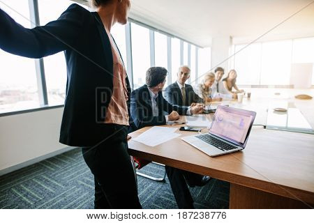 Corporate Professionals Have Meeting In Conference Room