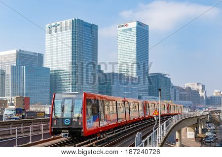 London UK - March 27 2017: Docklands Light Railway traain with Canary Wharf in the background