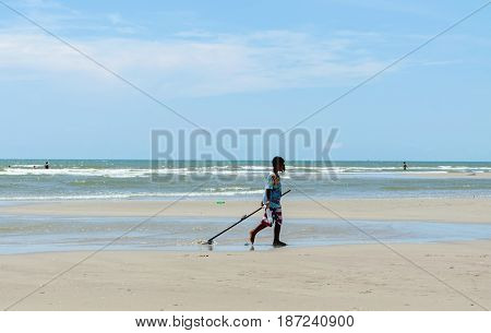 Hua-Hin Prachuabkirikhan Thailand - April 17 2017: young fisherman using the clam dredges at the beach.