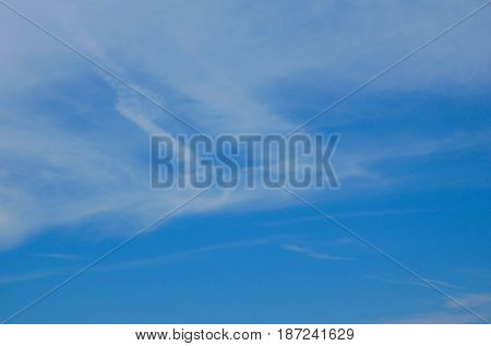 Clear blue sky and white clouds. Can be use as background.