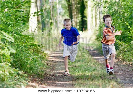 Young children running in nature