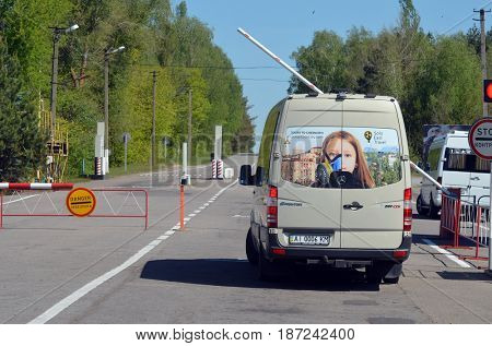 Checpoint of Chernobyl Exclusion Zone.Tourist transportation.,May 19, 2017.Kiev region.Ukraine