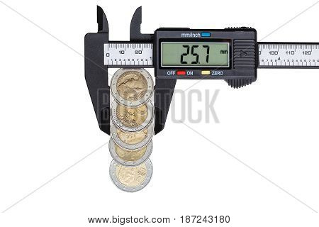 The digital caliper measures the diameter of 5 euro coins with a nominal value of 2 euros. Objects isolated on white background