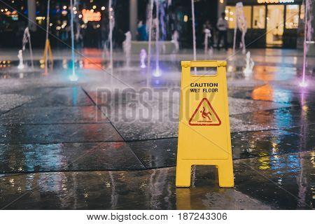 The wet floor caution on the wet floor