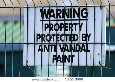 Warning sign for protection from crime by anti vandal paint.