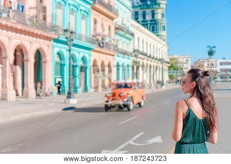 Tourist girl in popular area in Havana, Cuba. Young woman traveler smiling