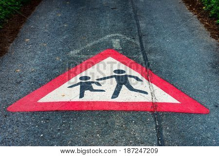 The Traffic sign Attention children playing on the floor of a street