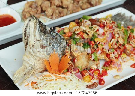 Fried snapper spicy is delicious on dish