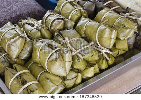 Kow Tom Mad. Thai steamed dessert made from sticky rice and banana wrapped in banana leaves.