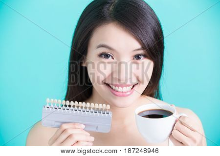 woman take tooth color palette and coffee with whiten concept