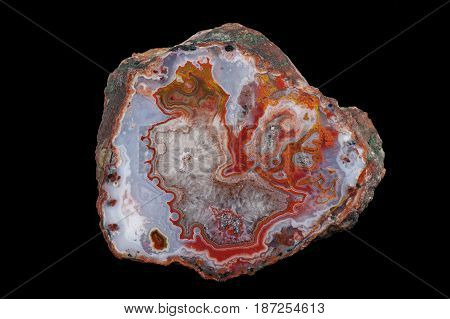 A cross section of the eyelet agate stone. Center filled with crystals of quartz. Multicolored silica bands colored with metal oxides are visible. Origin: Asni Atlas Mountains Morocco.
