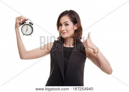 Young Asian Woman Show Thumbs Up With A Clock.