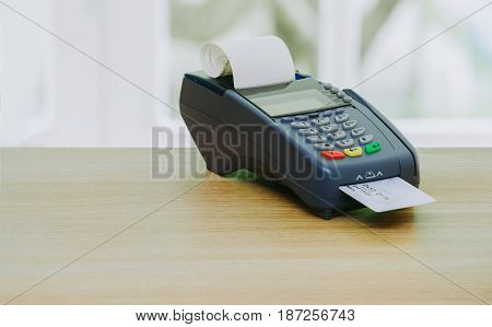 Credit card terminal or EDC machine on wooden background