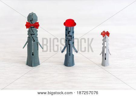 Building plastic dowel. Three dowels of gray color