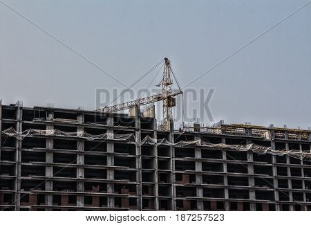 Hoisting cranes and building activity, tower crane on the construction site