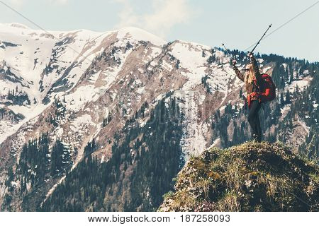 Happy Traveler standing on cliff mountaineering Travel Lifestyle concept adventure summer vacations hiking outdoor mountains landscape on background