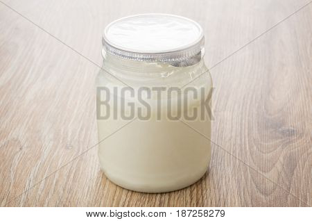Thermostat Yogurt In Plastic Transparent Jar On Table