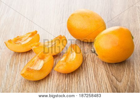 Full And Pieces Of Ripe Loquat On Table